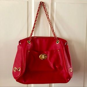 Red leather handbag with gold accents